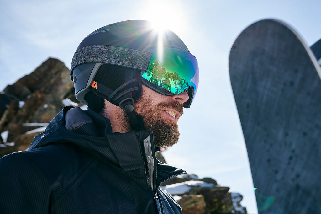 Man with helmet and goggles on mountain