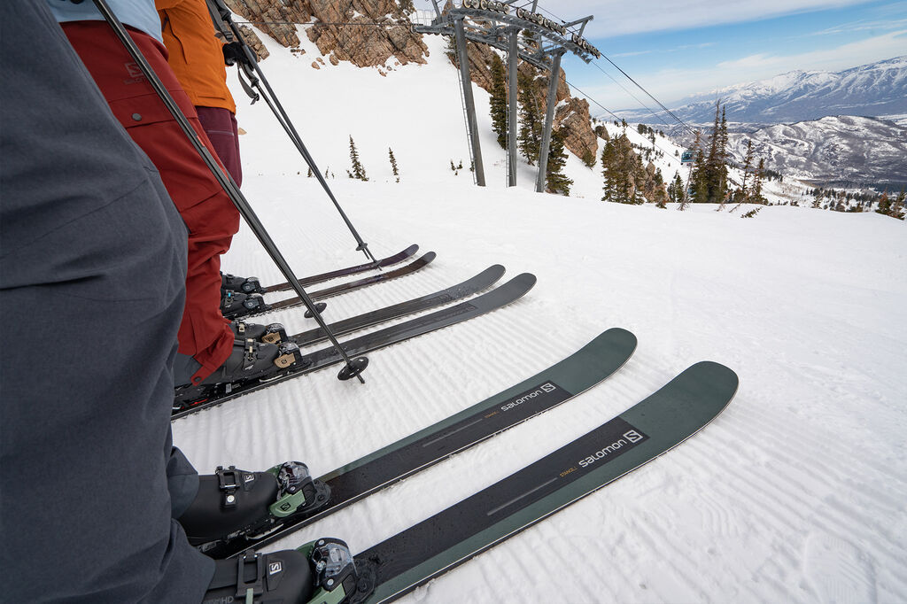 skiers on mountain with poles ready to ride
