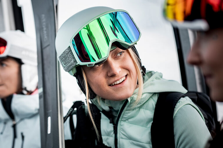 woman in atomic goggles with ski gear
