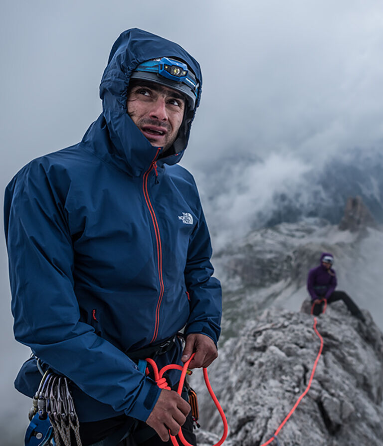 Man climbing in The North Face gear with FuseForm