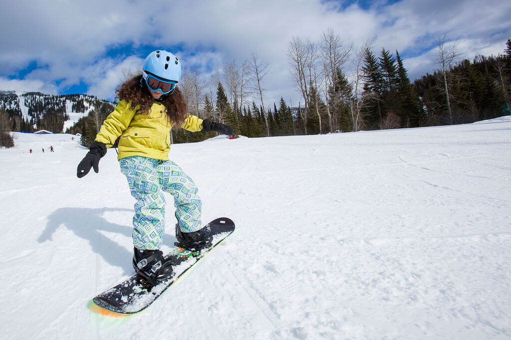 Girl ripping on snowboard